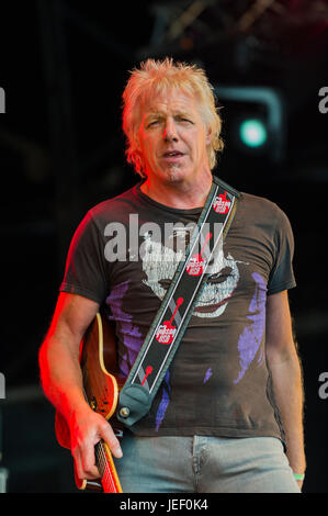 Dundrennan Scotland, UK - July 26, 2014: Simon Hough of Big Country, performing on the Summerisle stage at the Wickerman - Stock Photo