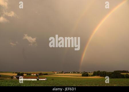 Rainbows in Bavaria after a summer thunderstorm., Regenbogen in Bayern nach einem Sommergewitter. - Stock Photo