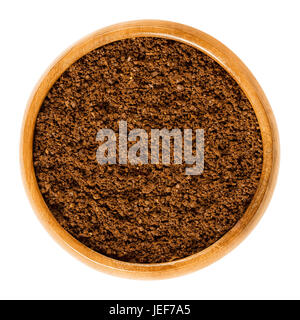 Fresh coffee powder in wooden bowl. Ground Arabica coffee beans. Roasted brown pits of coffee cherries. Caffeine. - Stock Photo
