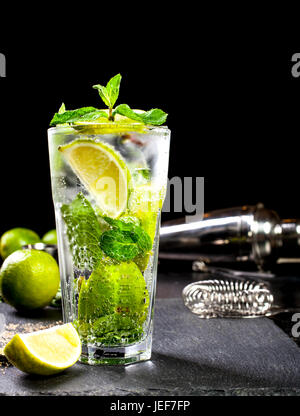 Closeup of mojito cocktail. Ingredients and bar utensils. Front view. - Stock Photo