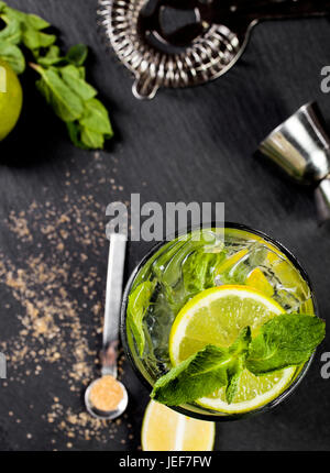 Closeup of mojito cocktail. Ingredients and bar utensils. Top view. - Stock Photo