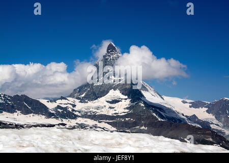 The Matterhorn in Switzerland is one of the highest mountains of the Alps with 4478-metre height., Das Matterhorn - Stock Photo