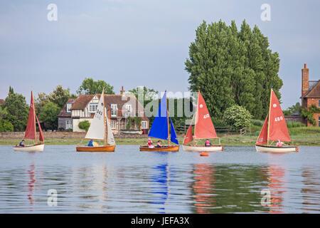 Sailing by the  attractive coastal village of Bosham, West Sussex, England, UK - Stock Photo