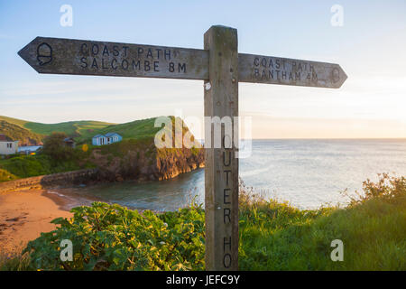 Southwest coast path sign, Shippen Beach, Outer Hope, Hope Cove, South Hams, South Devon, England, UK - Stock Photo