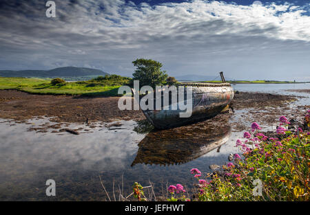 An old wrecked fishing boat on the Garavogue River at Rosses Point, County Sligo, Ireland - Stock Photo
