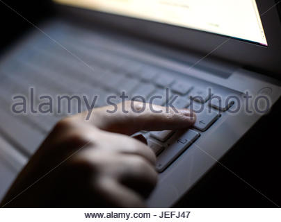 File photo dated 06/08/13 of someone using a laptop as Parliament has been hit by a cyber-security attack, said - Stock Photo