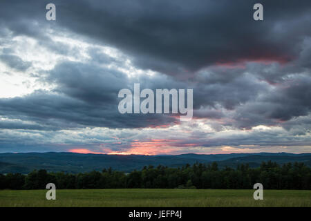 Dramatic Red Sunset Over Mountains - Stock Photo