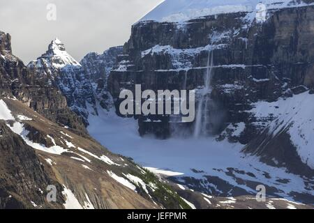Late Spring Avalanche from Mount Lefroy at top of Plain of Six Glaciers above Lake Louise, Banff National Park, - Stock Photo