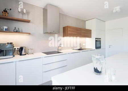 Modern kitchen interior with with built-in appliances - Stock Photo