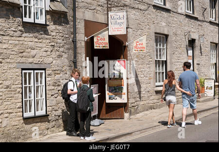 Corfe Castle Dorset England UK. People close to the model village entrance in this old historic English town. June - Stock Photo