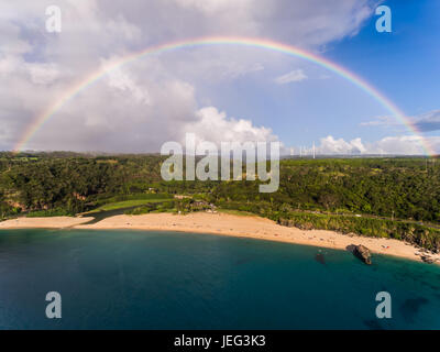 Aerial view of Waimea bay with a full Rainbow on the island of Oahu Hawaii - Stock Photo