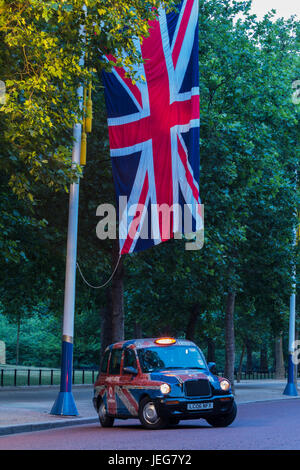 london taxi by union jack - Stock Photo