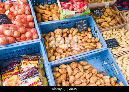 BELGIUM - BOMAL SUR OURTHE - JUNE 4, 2017: Potatoes and onions on the sunday market at Bomal Sur Ourthe in Belgium. - Stock Photo