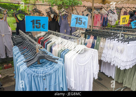 BELGIUM - BOMAL SUR OURTHE - JUNE 4, 2017: Clothes on the sunday market at Bomal Sur Ourthe in Belgium. - Stock Photo