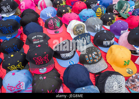 BELGIUM - BOMAL SUR OURTHE - JUNE 4, 2017: Caps on the sunday market at Bomal Sur Ourthe in Belgium. - Stock Photo