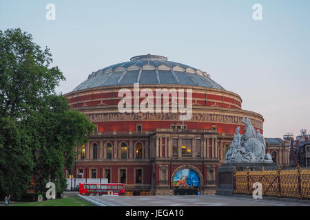 View of the Royal Albert Hall and a part of the Albert Memorial in Kensington Gardens, London in the evening. - Stock Photo