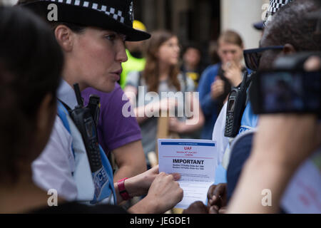 London, UK. 24th June, 2017. Police officers explain restrictions applicable under Sections 12 and 14 of the Public - Stock Photo