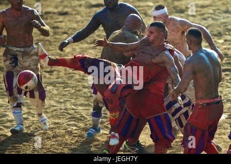 Florence, Italy. 24th June, 2017. Players compete during the final match of the Calcio Storico Fiorentino traditional - Stock Photo
