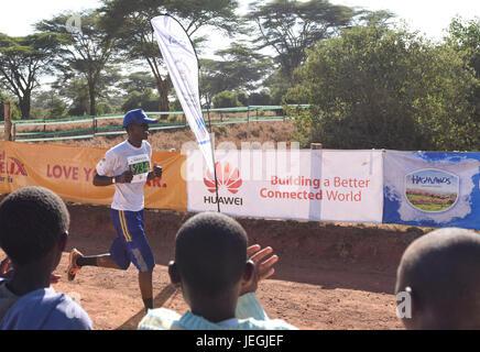 Nairobi. 24th June, 2017. A runner runs to the finish line during the 2017 Safaricom Lewa Marathon at northern Kenya's - Stock Photo