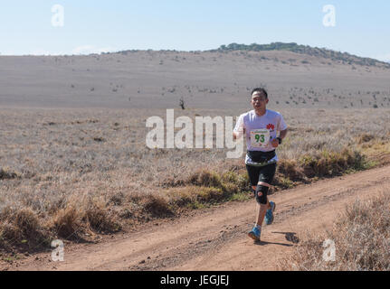 Nairobi. 24th June, 2017. A Chinese runner competes during the 2017 Safaricom Lewa Marathon at northern Kenya's - Stock Photo