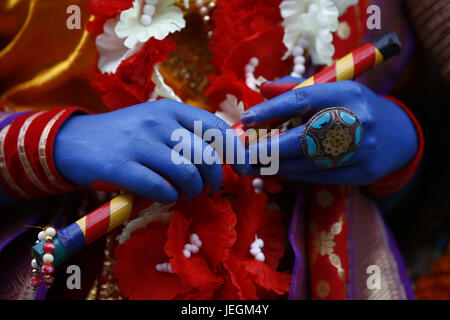 Kathmandu, Nepal. 25th June, 2017. Hands of a Nepalese person dressed as Hindu Deity Krishna are pictured as they - Stock Photo