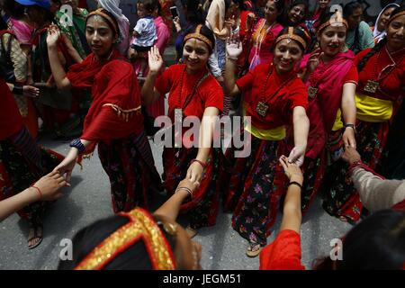 Kathmandu, Nepal. 25th June, 2017. Nepalese devotees dressed in traditional attire dance and sing during a procession - Stock Photo