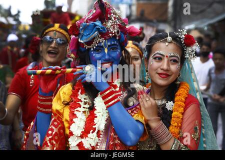 Kathmandu, Nepal. 25th June, 2017. Nepalese persons dressed as Hindu Deities take part in a procession to celebrate - Stock Photo