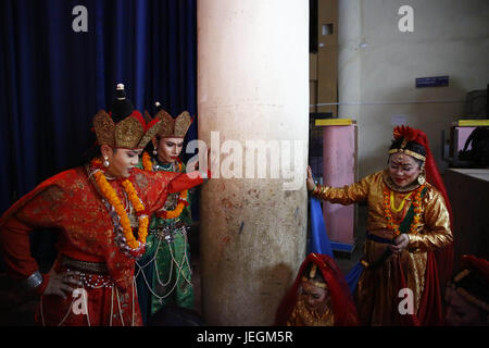 Kathmandu, Nepal. 25th June, 2017. Nepalese transgender dressed in traditional attire sit backstage before a cultural - Stock Photo
