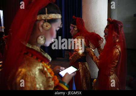 Kathmandu, Nepal. 25th June, 2017. Nepalese transgender dressed in traditional attire get ready backstage before - Stock Photo