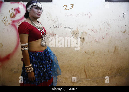 Kathmandu, Nepal. 25th June, 2017. A Nepalese transgender poses for another inside the dressing room before a cultural - Stock Photo
