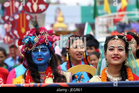 Kathmandu. 25th June, 2017. Participants dressed up as Lord Krishna and Goddess Radha participate in the procession - Stock Photo