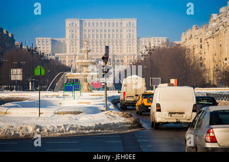 Bucharest city traffic with Parliament building in background, Romania - Stock Photo