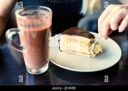 Eaing souffle cake with spoon in cafe - Stock Photo
