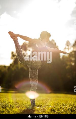 Caucasian woman in yoga standing balance Natarajasana. Back view - Stock Photo