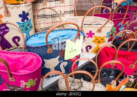 BELGIUM - BOMAL SUR OURTHE - JUNE 4, 2017: Shopping bags on the sunday market at Bomal Sur Ourthe in Belgium. - Stock Photo