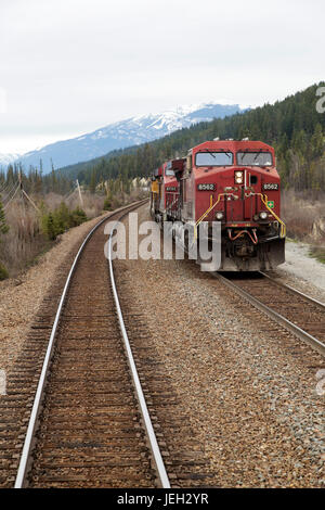 Locomotive pulling a freight train on the Canadian Pacific Railway near Revelstoke in British Columbia, Canada. - Stock Photo