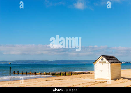 white houses on the beach, whitel door to summer cottages, seaside spot, vacation - Stock Photo