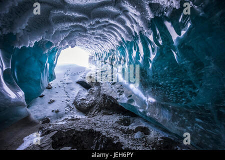 Hoarfrost covers the ceiling of a Canwell Glacier ice cave in winter; Alaska, United States of America - Stock Photo