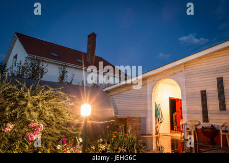 View of the cottage from the back yard. - Stock Photo