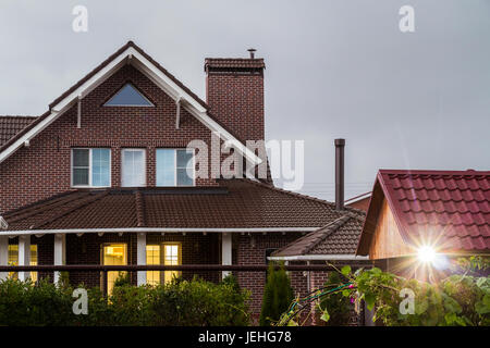 Evening view from the backyard to the house. - Stock Photo