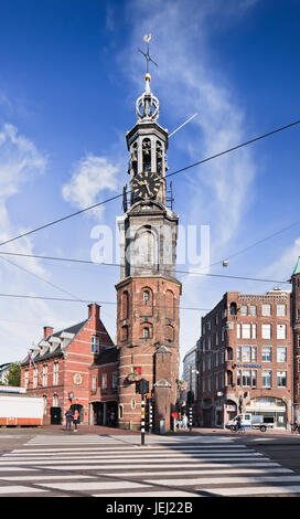 AMSTERDAM-AUG. 27, 2014. The Munt Tower with a zebra path in front. The tower was originally part of one of the - Stock Photo