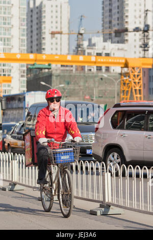BEIJING–MARCH 27, 2012. Fast food courier on March 27, 2012 in Beijing. China's breathless expanded chain restaurants - Stock Photo