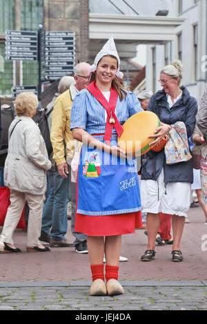 GOUDA-HOLLAND-AUGUST 21, 2014. Traditional dressed Dutch girl on a cheese market. Gouda has a regular traditional - Stock Photo
