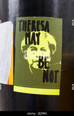 Shoreditch, London, UK. 25th June, 2017. Theresa May Be Not written on a sticker above the prime minister portrait. - Stock Photo