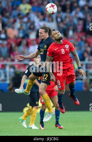 Moscow, Russia. 25th June, 2017. Jackson Irvine (L) of Australia vies for the ball with Arturo Vidal of Chile during - Stock Photo