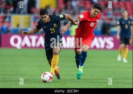 Moscow, Russia. 25th June, 2017. Massimo Luongo (L) of Australia vies for the ball with Pablo Hernandez of Chile - Stock Photo