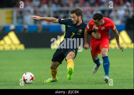 Moscow, Russia. 25th June, 2017. Mathew Leckie (L) of Australia vies for the ball with Jose Fuenzalida of Chile - Stock Photo