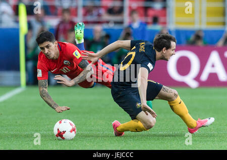 Moscow, Russia. 25th June, 2017. Pablo Hernandez (L) of Chile vies for the ball with Robbie Cruse of Australia during - Stock Photo