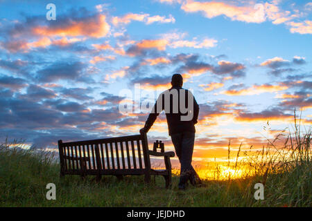 Southport, Merseyside, 26th June 2017. UK Weather. An early morning birdwatcher observes a beautiful sunrise during - Stock Photo