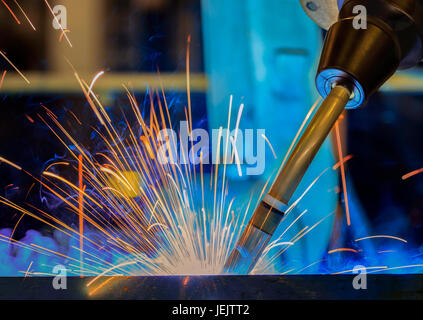 Close-up robot welding in car factory - Stock Photo